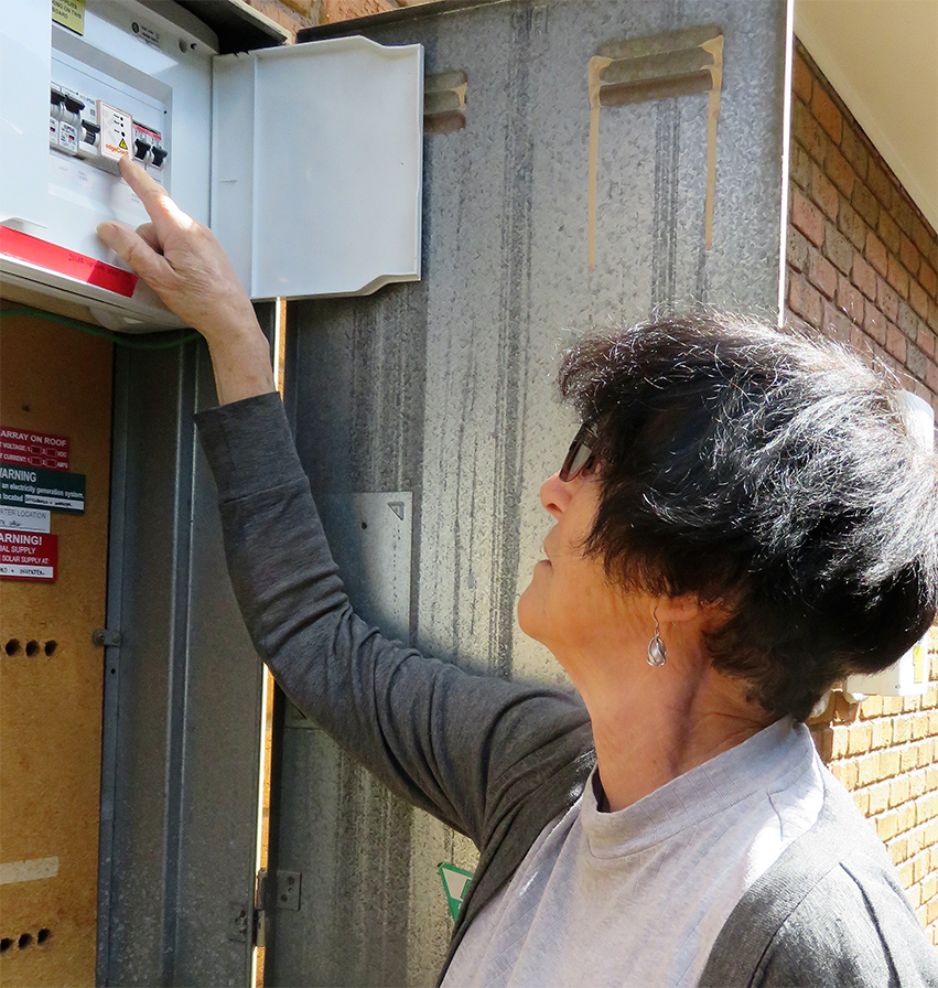 The compact device is installed within the home's switchboard